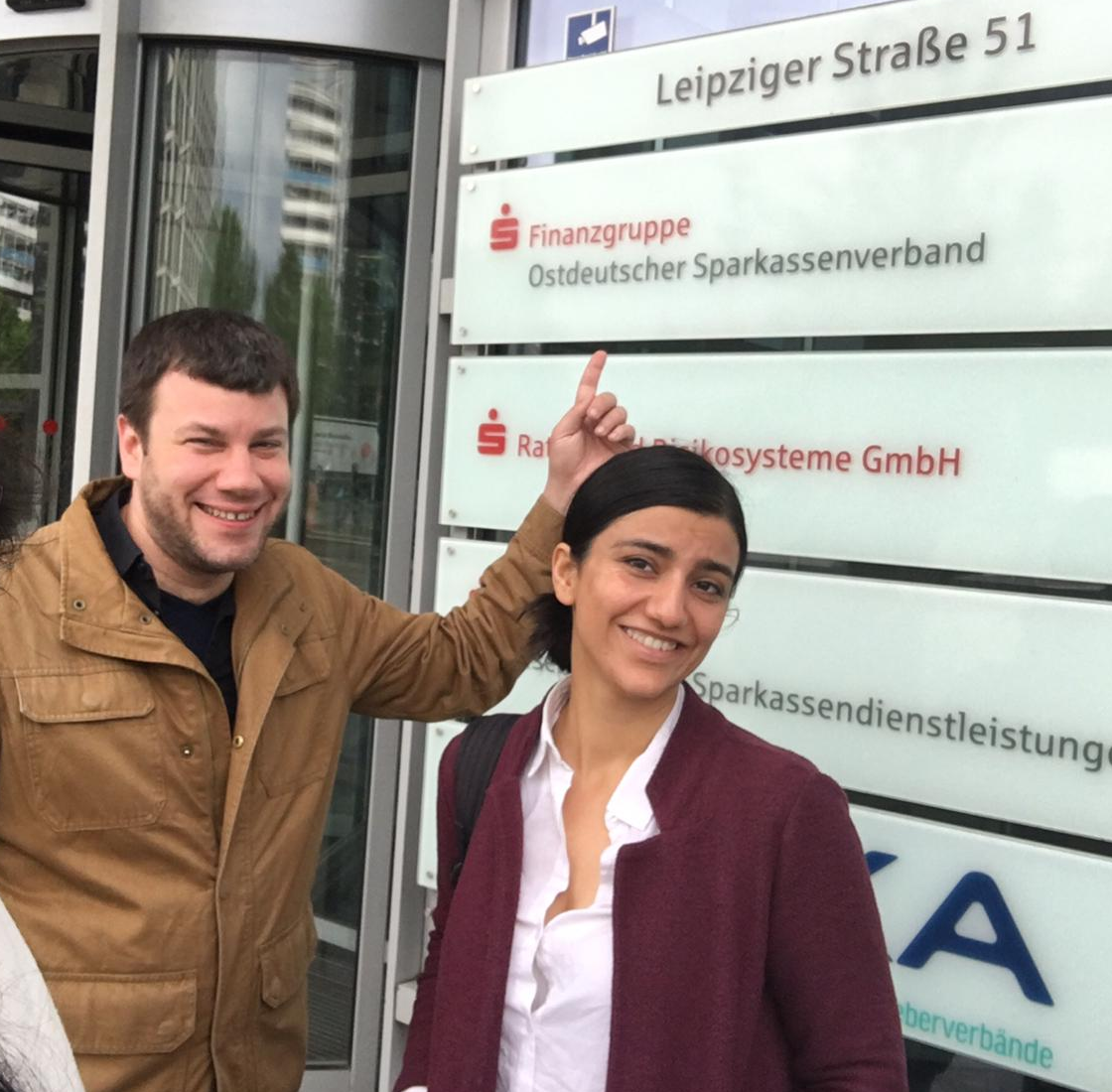 Ali Issa and interpreter Schluwa Sama outside Sparkassen-Finanzgruppe
